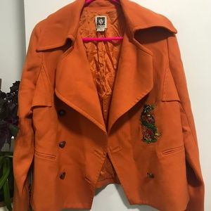 Orange coat with dragon patch